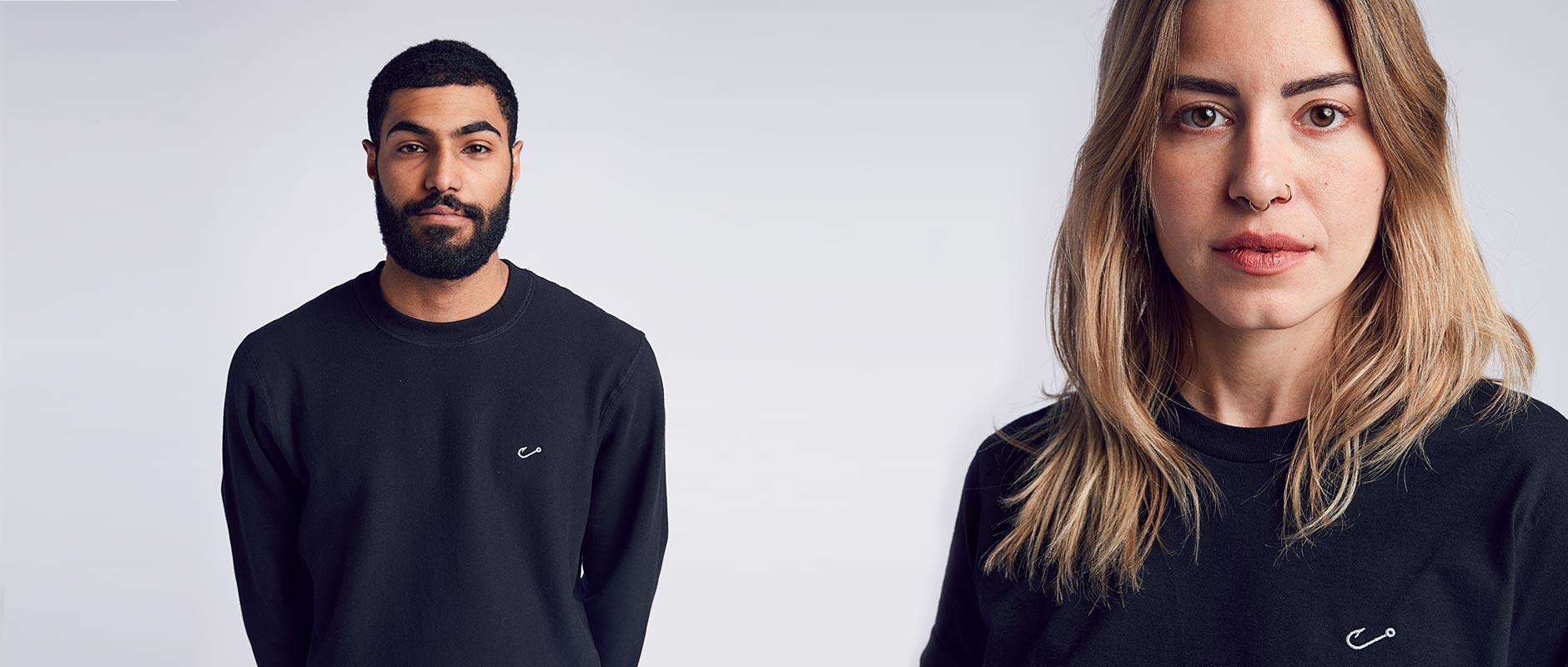 Male and Female models wearing Black Embroidered Hook Crewneck